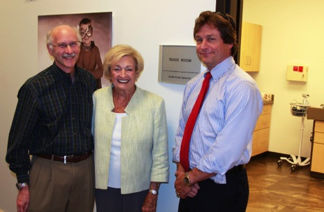 David Bick, Loretta Spencer and Howard Jacob in front of the triage room at the Smith Family Clinic for Genomic Medicine