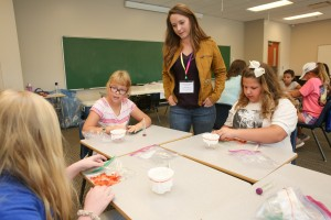HudsonAlpha's Krysta Engel, PhD, helps girls with DNA extraction at Girls' Science and Engineering day on Saturday, Nov. 5, 2016. (Photo credit: Michael Mercier/UAH).
